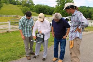 Tim gives a summary of the remote sensing survey to date. L to R: Aaron Deter-Wolf, Tim DeSmet, Mike Moore, Jesse Tune.
