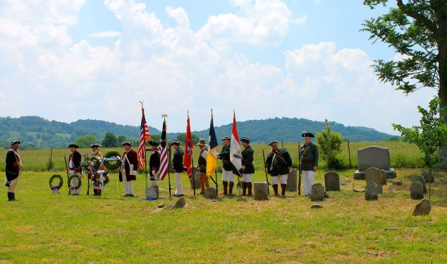 Members of the Sons of the American Revolution presenting the colors.