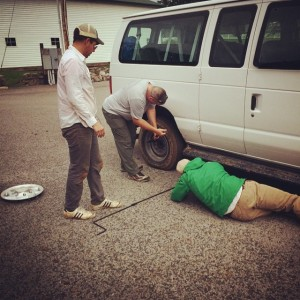 Field Assistant Joey Keasler changes the flat tire on the field school van (with help from the students). Thanks guys!