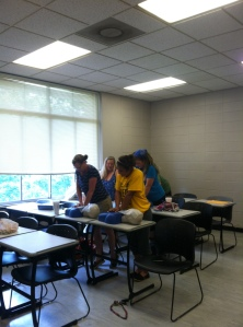 Field school students practicing  CPR.